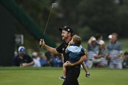 Jul 31, 2016; Springfield, NJ, USA; Jimmy Walker celebrates with his family on the 18th green after winning the tournament during the Sunday round of the 2016 PGA Championship golf tournament at Baltusrol GC - Lower Course. Eric Sucar-USA TODAY Sports