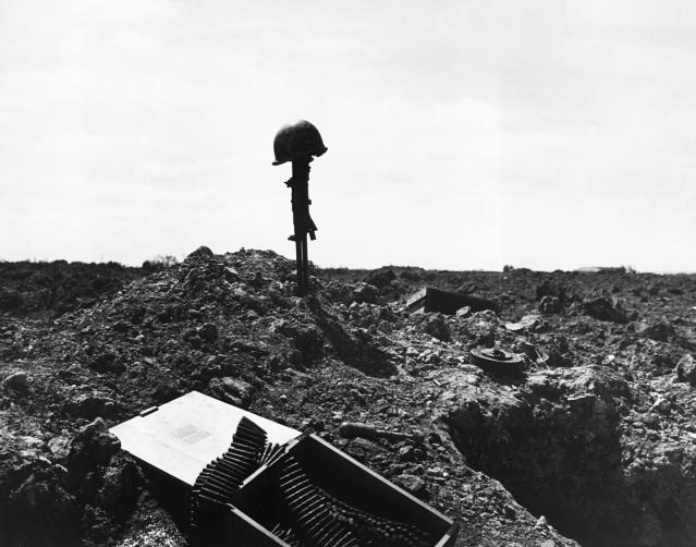 <p>This monument to an unidentified American soldier who died in the D-Day assault was placed on the shell-blasted shore of Normandy, France, after the invasion in June 1944. (Photo: Corbis via Getty Images) </p>