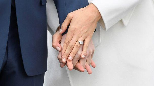 PHOTO: Britain's Prince Harry holds hands with Meghan Marklem wearing an engagement ring in the Sunken Garden of Kensington Palace, London, Nov. 27, 2017. (Toby Melville/Reuters)