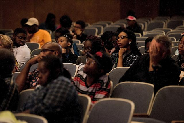 """The crowd listens to the speakers during the """"Victory Over Violence: Overcoming Gangs in Little Rock""""€ event."""