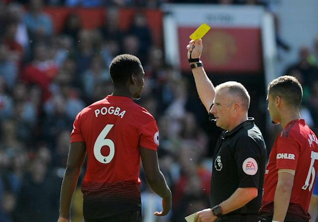 Paul Pogba receives a yellow card during the English Premier League soccer match between Manchester United and Cardiff City at Old Trafford in Manchester, England, Sunday, May 12, 2019. (AP Photo/Rui Vieira)