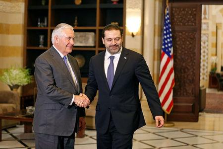 Lebanon's Prime Minister Saad al-Hariri shakes hands with U.S. Secretary of State Rex Tillerson at the governmental palace in Beirut, Lebanon, February 15, 2018. REUTERS/Jamal Saidi