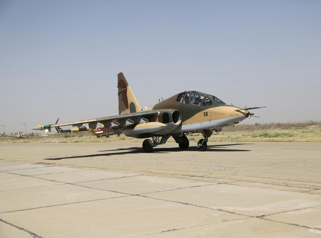 A Russian Sukhoi Su-25 fighter plane lands as it arrives at Iraq's al-Muthanna military airbase at Baghdad airport, in Baghdad, July 1, 2014. Iraq's defence ministry said on Tuesday that the second batch of Russian Sukhoi (Su-25) fighter jets that arrived in Baghdad will be used to back Iraqi troops that continue to battle Islamic State militants, previously known as the Islamic State of Iraq and the Levant (ISIL), in the country's northern provinces. REUTERS/Stringer (IRAQ - Tags: CIVIL UNREST POLITICS TRANSPORT MILITARY CONFLICT)