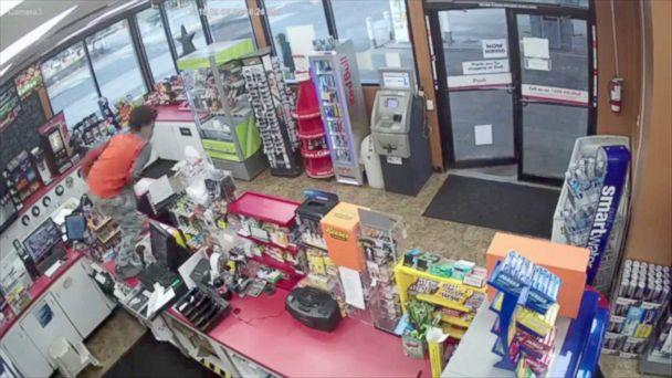 PHOTO: 2 young males appear to step around collapsed clerk to rob store. (Facebook/Auburn, Wash., Police Department)
