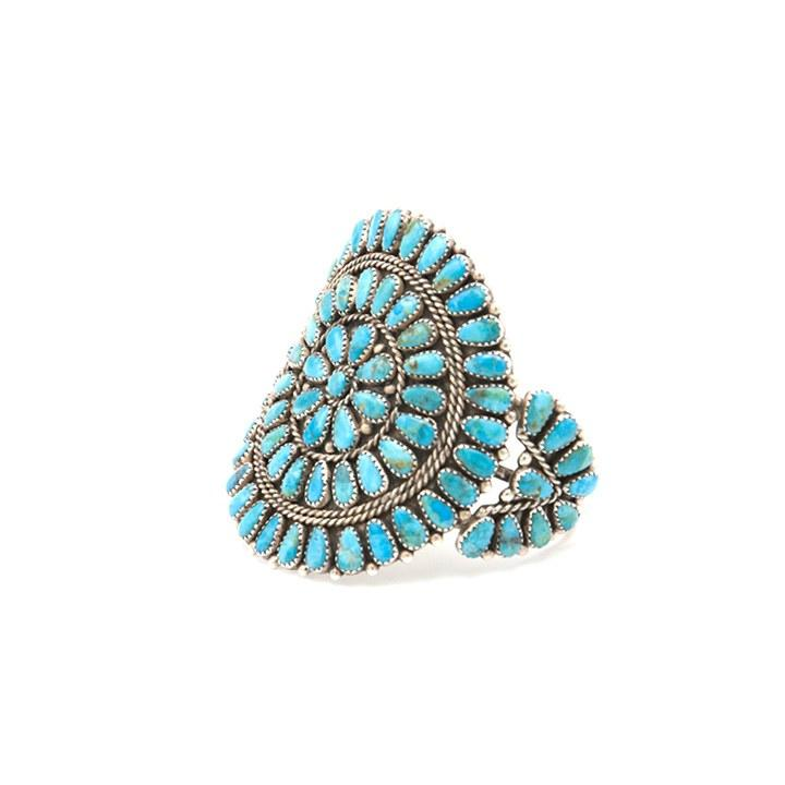 """<p>Bow and Arrow, Kingman Cluster Round Cuff, Navajo handcrafted with Kingman Turquoise cluster style cuff. Made by Artist Rex Tso. $495, <a rel=""""nofollow"""" href=""""https://www.bowandarrownyc.com/?mbid=synd_yahoolife"""">bowandarrownyc.com</a></p>"""