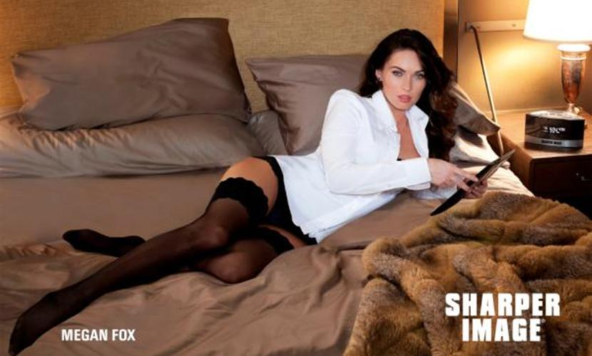 Sexy celebrity ad campaigns: Megan Fox has tipped the scales of sexiness once more as she slipped into stockings for electronics company, Sharper Image. The actress donned black hold ups and a white shirt to entice (the male population) to purchase the firm's products.  Photo: Sharper Image