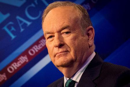 """FILE PHOTO - Fox News Channel host Bill O'Reilly poses on the set of his show """"The O'Reilly Factor"""" in New York"""