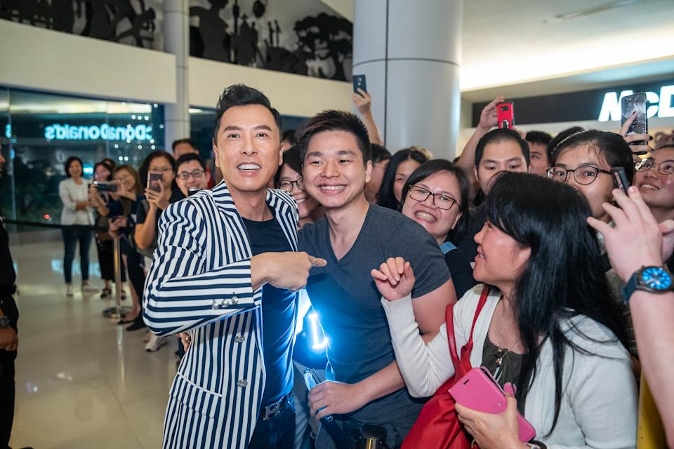 Hong Kong action film actor Donnie Yen (in striped jacket) interacting with fans before a gala premiere of Ip Man 4: The Finale at Shaw Theatres Lido in Singapore on 10 December 2019. (PHOTO: Shaw Organisation)