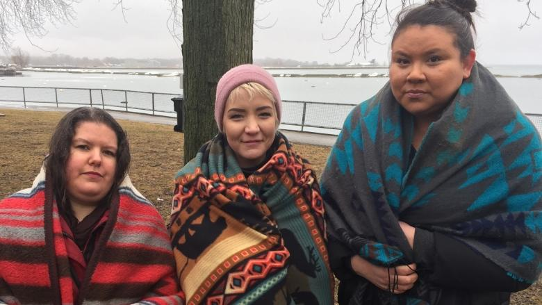 Blanket-wrapped marchers walk silently to honour Tina Fontaine in Toronto