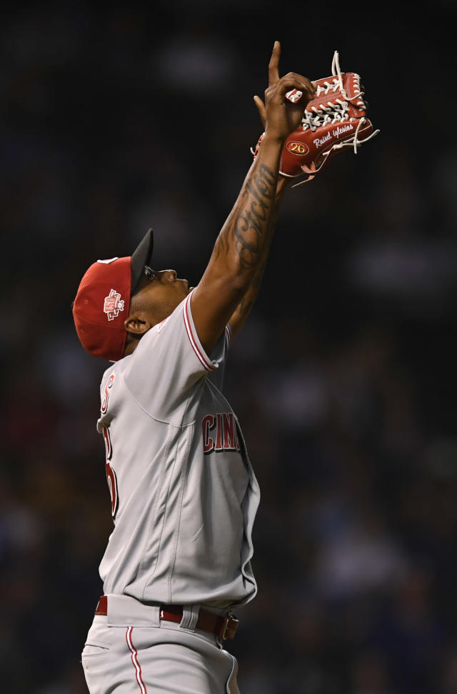 Cincinnati Reds closing pitcher Raisel Iglesias celebrates after defeating the Chicago Cubs in a baseball game Monday, July 15, 2019, in Chicago. (AP Photo/Paul Beaty)