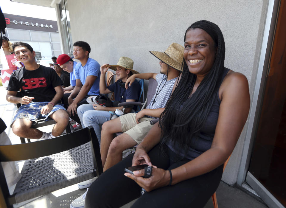 Janet Raines of Los Angeles says she arrived at 7:30 a.m. to be the first in line to see LeBron James at Blaze Pizza. (AP Photo)
