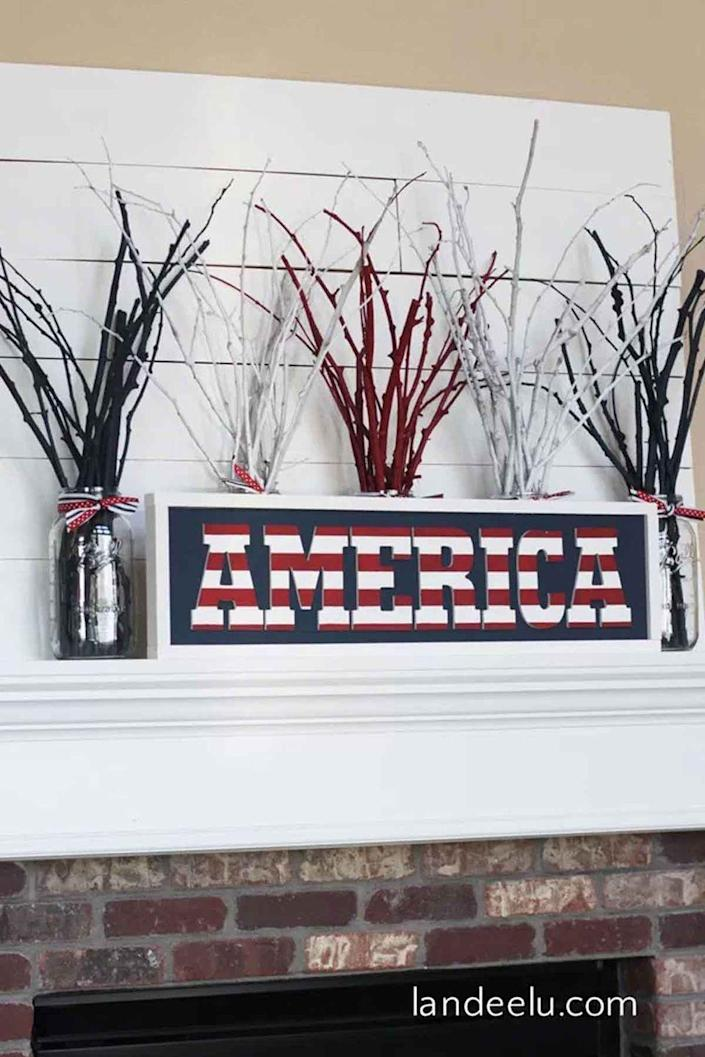 """<p>This DIY America sign definitely has more charm than anything you'd find in a store. </p><p><em><strong>Get the tutorial from <a href=""""http://www.landeeseelandeedo.com/2016/06/diy-independence-day-america-sign.html"""" rel=""""nofollow noopener"""" target=""""_blank"""" data-ylk=""""slk:Landeelu"""" class=""""link rapid-noclick-resp"""">Landeelu</a>. </strong></em> </p>"""