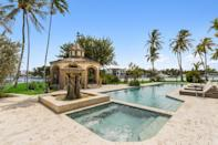 <p>The backyard boasts a decorative piazza, an oversized lap pool, a jacuzzi with sculptured fountain, and an amphitheater stage—all just steps from the Intercostal Waterway.</p>