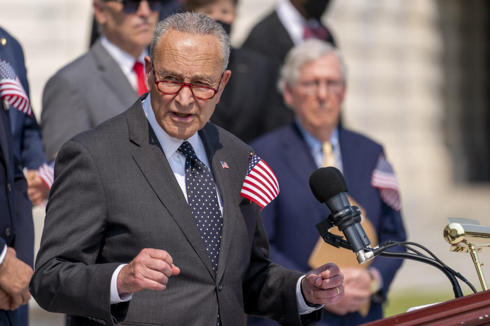 Senate Majority Leader Chuck Schumer of N.Y., accompanied by Senate Minority Leader Mitch McConnell of Ky., right, and other Members of Congress, speaks at a Congressional Remembrance Ceremony marking the 20th anniversary of the Sept. 11, 2001, terrorist attacks, on Capitol Hill in Washington, Monday, Sept. 13, 2021. (AP Photo/Andrew Harnik)