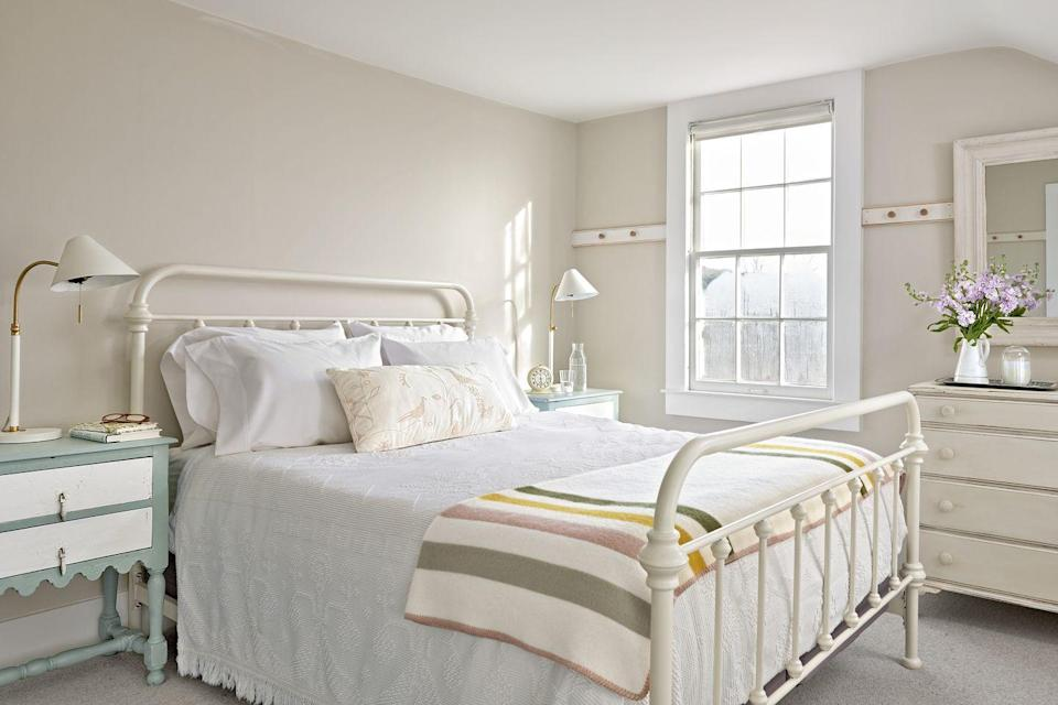 """<p>For an all-white look with just a little oomph, try an antique white paint color for the walls, then paint the trim and other millwork a brighter white to accentuate the pretty detailing. Complete the pretty tone-on-tone with farmhouse classics such as a white iron bed and white matelassé bedding. </p><p><strong>Get the Look: </strong><br>Wall Paint Color: <a href=""""https://store.benjaminmoore.com/storefront/index.ep"""" rel=""""nofollow noopener"""" target=""""_blank"""" data-ylk=""""slk:Balboa Mist by Benjamin Moore"""" class=""""link rapid-noclick-resp"""">Balboa Mist by Benjamin Moore<br></a>Bed: <a href=""""https://go.redirectingat.com?id=74968X1596630&url=https%3A%2F%2Fwww.overstock.com%2FHome-Garden%2FGiselle-Graceful-Lines-Victorian-Iron-Metal-Bed-by-iNSPIRE-Q-Classic%2F9116507%2Fproduct.html&sref=https%3A%2F%2Fwww.countryliving.com%2Fremodeling-renovation%2Fhome-makeovers%2Fg32468539%2Fbest-bedroom-paint-colors-ideas%2F"""" rel=""""nofollow noopener"""" target=""""_blank"""" data-ylk=""""slk:Giselle Iron Metal Bed; overstock.com"""" class=""""link rapid-noclick-resp"""">Giselle Iron Metal Bed; <em>overstock.com</em></a><br>Bedding: <a href=""""https://go.redirectingat.com?id=74968X1596630&url=https%3A%2F%2Fwww.wayfair.com%2Fkeyword.php%3Fkeyword%3Dmatelasse%2Bcoverlet&sref=https%3A%2F%2Fwww.countryliving.com%2Fremodeling-renovation%2Fhome-makeovers%2Fg32468539%2Fbest-bedroom-paint-colors-ideas%2F"""" rel=""""nofollow noopener"""" target=""""_blank"""" data-ylk=""""slk:Matelassé Coverlet; wayfair.com"""" class=""""link rapid-noclick-resp"""">Matelassé Coverlet; <em>wayfair.com</em></a></p>"""