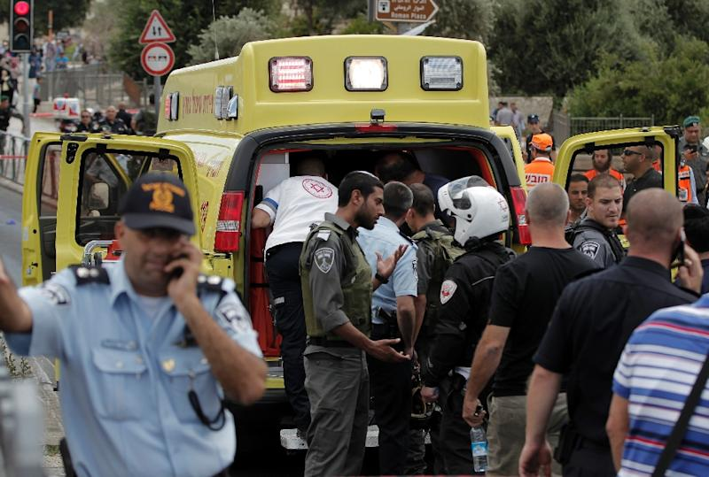 Israeli medical team gathers at the site of a stabbing attack carried out by an 18-year-old Palestinian on an Israeli border policeman on June 21, 2015, at the Damascus Gate outside the old city of Jerusalem (AFP Photo/Ahmad Gharabli)