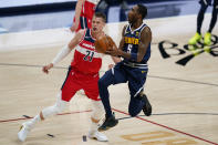 Denver Nuggets forward Will Barton (5) goes up for a shot against Washington Wizards center Moritz Wagner (21) during the first quarter of an NBA basketball game Thursday, Feb. 25, 2021, in Denver. (AP Photo/Jack Dempsey)