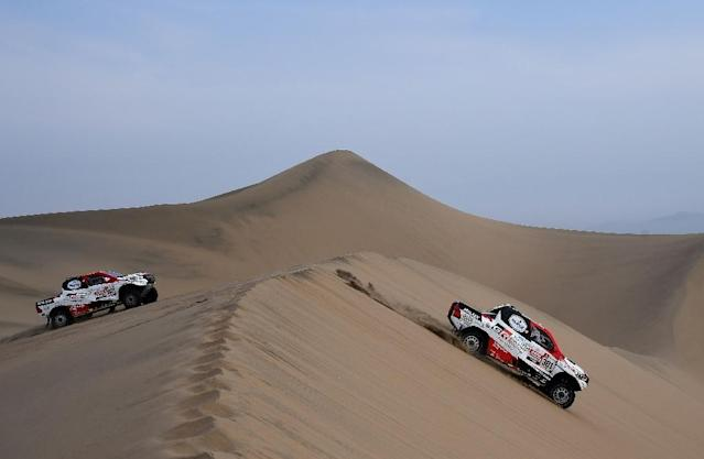 Qatar's Nasser Al-Attiyah of (R) won this year's Dakar in Peru (AFP Photo/FRANCK FIFE)