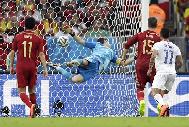 Spain's goalkeeper Iker Casillas can't stop a shot by Chile's Charles Aranguiz allowing Chile to score their side's second goal during the group B World Cup soccer match between Spain and Chile at the Maracana Stadium in Rio de Janeiro, Brazil, Wednesday, June 18, 2014
