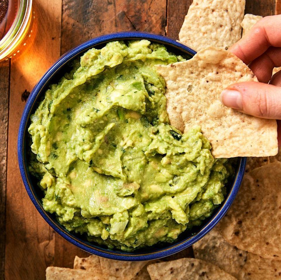 "<p>Everyone has opinions about guac. Some, like us, like it simple. We prefer to let the flavour of our avo's shine. Others like to go crazy on the mix-ins: spices, tomatoes, garlic, etc. If that's your thing, this guacamole is the perfect jumping off point. Add whatever you like! </p><p>Get the <a href=""https://www.delish.com/uk/cooking/recipes/a29947768/best-ever-guacamole-recipe/"" rel=""nofollow noopener"" target=""_blank"" data-ylk=""slk:Guacamole"" class=""link rapid-noclick-resp"">Guacamole</a> recipe.</p>"