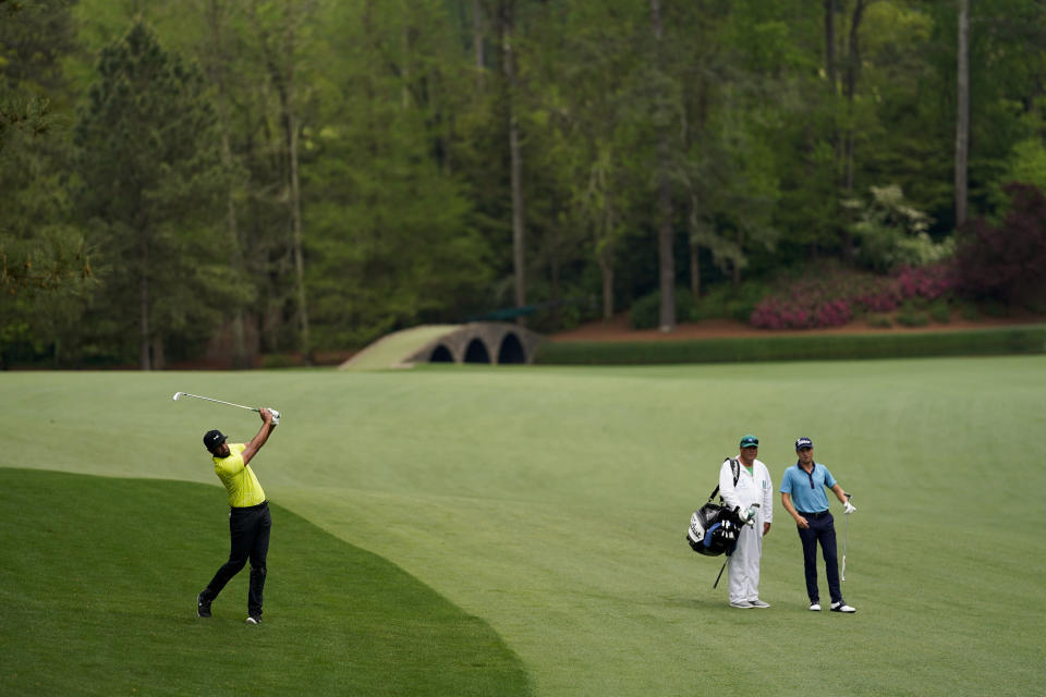 Justin Thomas, right, watches as Tony Finau his on the 13th hole during the second round of the Masters golf tournament on Friday, April 9, 2021, in Augusta, Ga. (AP Photo/David J. Phillip)