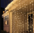 """<p><strong>The Holiday Aisle</strong></p><p>wayfair.com</p><p><strong>$39.99</strong></p><p><a href=""""https://go.redirectingat.com?id=74968X1596630&url=https%3A%2F%2Fwww.wayfair.com%2Flighting%2Fpdp%2Fthe-holiday-aisle-vanbuskirk-98-ft-320-lights-curtain-string-light-trch1038.html&sref=https%3A%2F%2Fwww.countryliving.com%2Fhome-design%2Fdecorating-ideas%2Fg31137877%2Foutdoor-lighting-ideas%2F"""" rel=""""nofollow noopener"""" target=""""_blank"""" data-ylk=""""slk:Shop Now"""" class=""""link rapid-noclick-resp"""">Shop Now</a></p><p>If mosquitoes are a concern, consider pairing these curtain lights with netting for coverage and illumination. They're available in warm white, blue, and daylight hues.</p>"""
