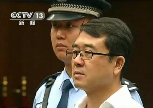 This frame grab, taken from Chinese television CCTV on September 18, shows former police chief Wang Lijun (R) facing the court during his trial in Chengdu, in southwest China's Sichuan province. Judgement in the case of Wang, who was tried for defection and other offences in a scandal that brought down top politician Bo Xilai, will be given on Monday, a court official told AFP