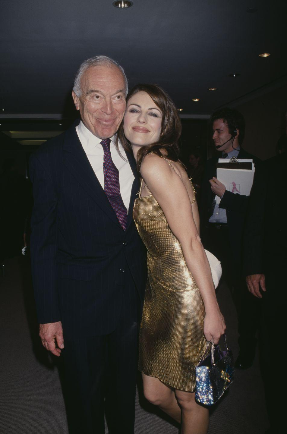 <p>Elizabeth posing with the Chief Executive Officer of Estée Lauder at the time, Leonard Lauder, at an event for the company at Christie's.</p>