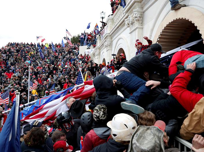 <p>Pro-Trump protesters storm into the US Capitol during clashes with police, during a rally to contest the certification of the 2020 presidential election results</p> (REUTERS)