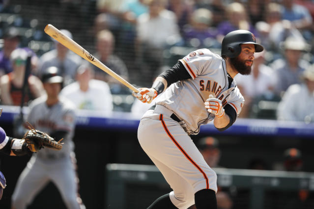 San Francisco Giants' Brandon Belt follows the flight of his RBI-single off Colorado Rockies relief pitcher Carlos Estevez in the seventh inning of a baseball game Wednesday, July 17, 2019, in Denver. (AP Photo/David Zalubowski)
