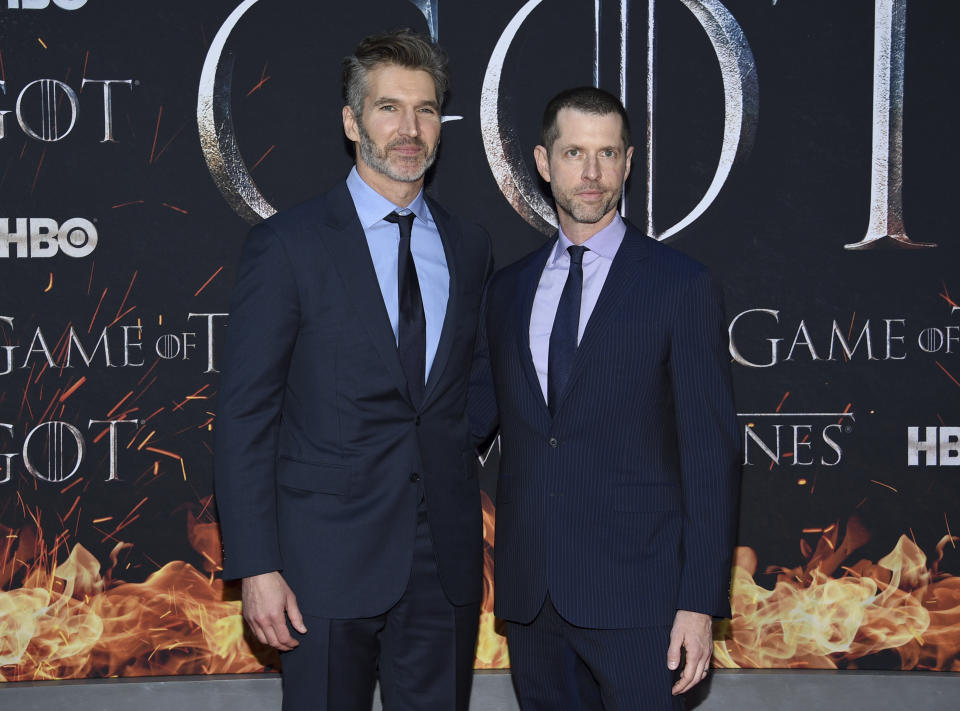 """Creators and executive producers David Benioff, left, and D.B. Weiss pose together at HBO's """"Game of Thrones"""" final season premiere at Radio City Music Hall on Wednesday, April 3, 2019, in New York. (Photo by Evan Agostini/Invision/AP)"""