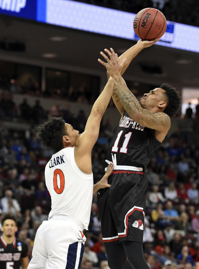 Gardner-Webb's David Efianayi (11) shoots over Virginia's Kihei Clark (0) during a first-round game in the NCAA mens college basketball tournament in Columbia, S.C., Friday, March 22, 2019. (AP Photo/Richard Shiro)