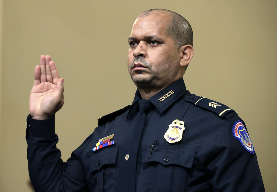 U.S. Capitol Police Sgt. Aquilino Gonell is sworn in before the House select committee hearing on the Jan. 6 attack on Capitol Hill in Washington, Tuesday, July 27, 2021. (Chip Somodevilla/Pool via AP)