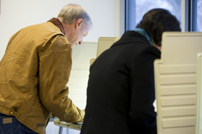 Illinois Republican gubernatorial candidate Bruce Rauner, left, and his wife, Diana Rauner, vote on Tuesday, March 18, 2014, in Winnetka, Ill. Rauner faces State Sen. Bill Brady, State Sen. Kirk Dillard and State Treasurer Dan Rutherford in the primary election. (AP Photo/Andrew A. Nelles)