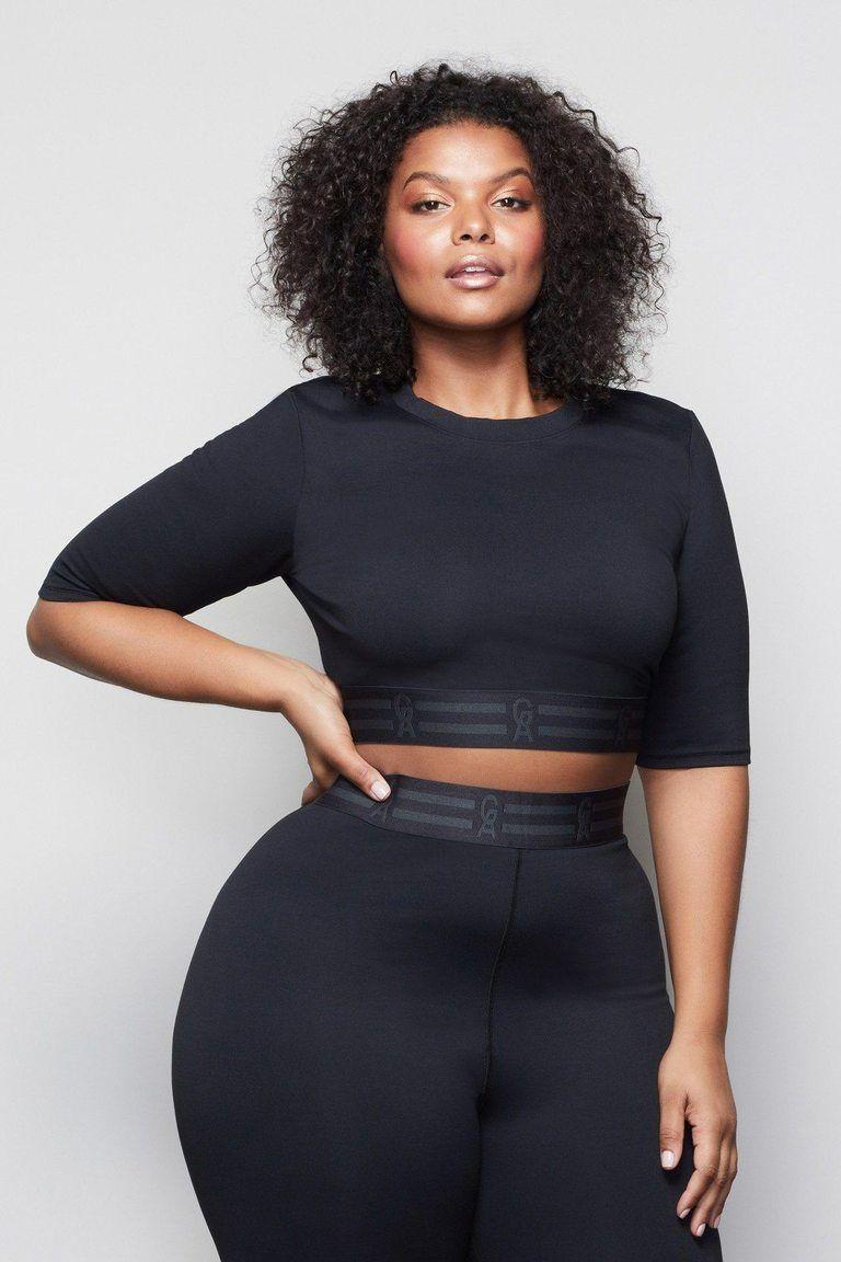 """<p><strong>Good American</strong></p><p>goodamerican.com</p><p><strong>$75.00</strong></p><p><a href=""""https://go.redirectingat.com?id=74968X1596630&url=https%3A%2F%2Fwww.goodamerican.com%2Fproducts%2Ficon-crop-top-black001%3Fvariant%3D12253206937657&sref=https%3A%2F%2Fwww.harpersbazaar.com%2Ffashion%2Ftrends%2Fg36721962%2Fbest-plus-size-crop-tops%2F"""" rel=""""nofollow noopener"""" target=""""_blank"""" data-ylk=""""slk:Shop Now"""" class=""""link rapid-noclick-resp"""">Shop Now</a></p><p>Good American's mid-length crop top can skew athleisure or pair with denim to change the whole vibe.</p>"""
