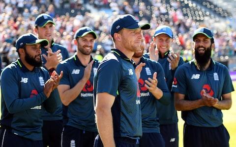 <span>England's player Jos Buttler (C) is applauded by teammates before being awarded Man of the Match and the Man of the Series</span> <span>Credit: AFP </span>