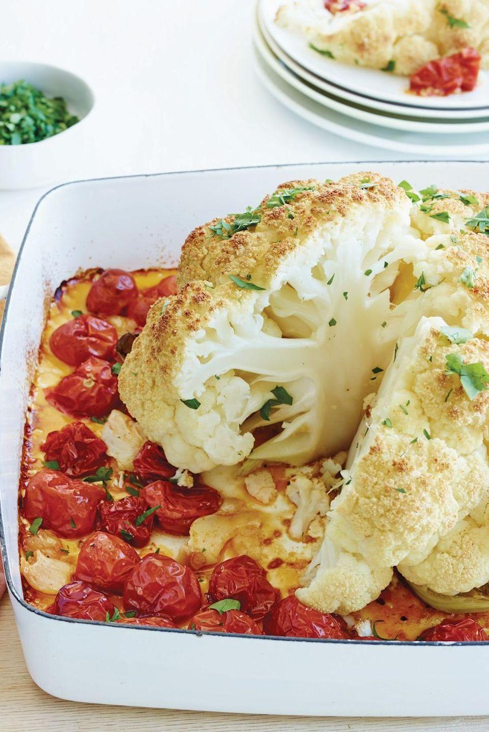 """<p>We love the drama of this <a href=""""https://www.delish.com/uk/cooking/recipes/a29695647/thanksgiving-cauliflower-recipe/"""" rel=""""nofollow noopener"""" target=""""_blank"""" data-ylk=""""slk:whole roasted cauliflower"""" class=""""link rapid-noclick-resp"""">whole roasted cauliflower</a>—the presentation, the slicing—which always brings down the house.</p><p>Get the <a href=""""https://www.delish.com/uk/cooking/recipes/a34639851/whole-roasted-cauliflower-tomatoes-and-garlic-recipe/"""" rel=""""nofollow noopener"""" target=""""_blank"""" data-ylk=""""slk:Whole Roasted Cauliflower, Tomatoes and Garlic"""" class=""""link rapid-noclick-resp"""">Whole Roasted Cauliflower, Tomatoes and Garlic</a> recipe.</p>"""