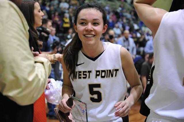 The tournament's most valuable player, Army's Kelsey Minato, celebrates after receiving her award after beating Holy Cross in an NCAA college basketball game in the Patriot League Championship at Christi Arena, Saturday, March 15, 2014, at West Point, N.Y. Army won 68-58. (AP Photo/Karl Rabe)
