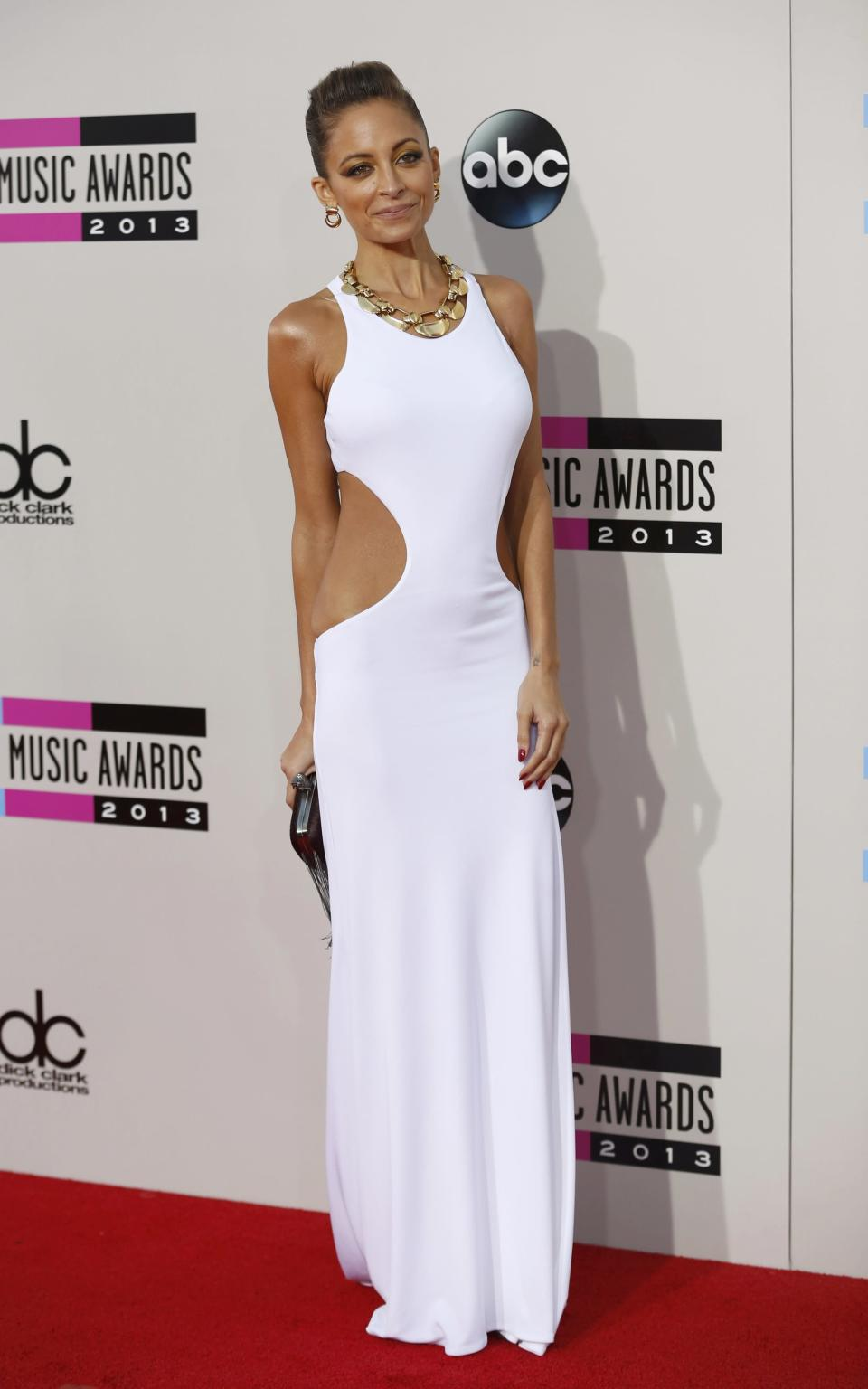 Nicole Richie has gained a reputation for taking risks on the red carpet, but this slim white dress with the too-large side cutouts doesn't flatter the slender fashionista's boyish figure at all. From the shoulders up, Richie looks good, but the rest of the dress seems ill-fitting. REUTERS/Mario Anzuoni (UNITED STATES - TAGS: ENTERTAINMENT)(AMA-ARRIVALS)