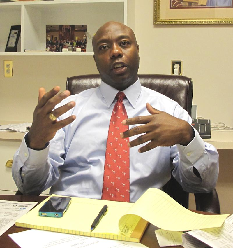 Tim Scott, elected as the nation's first black GOP congressman in seven years and the first from the Deep South since Reconstruction, discusses his election during an Associated Press interview in Charleston, S.C., on Wednesday, Nov. 3, 2010. (AP Photo/Bruce Smith)