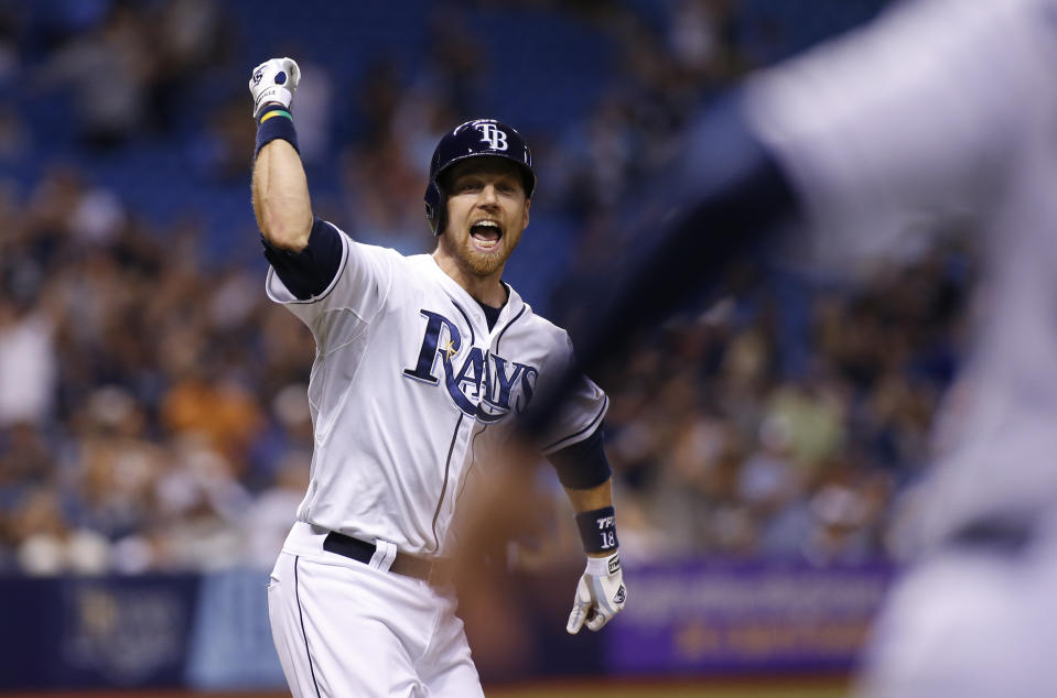 ST. PETERSBURG, FL - SEPTEMBER 15:  Ben Zobrist #18 of the Tampa Bay Rays celebrates his walk off single with the bases loaded to score Logan Forsythe during the ninth inning of a game against the New York Yankees on September 15, 2014 at Tropicana Field in St. Petersburg, Florida.  (Photo by Brian Blanco/Getty Images)