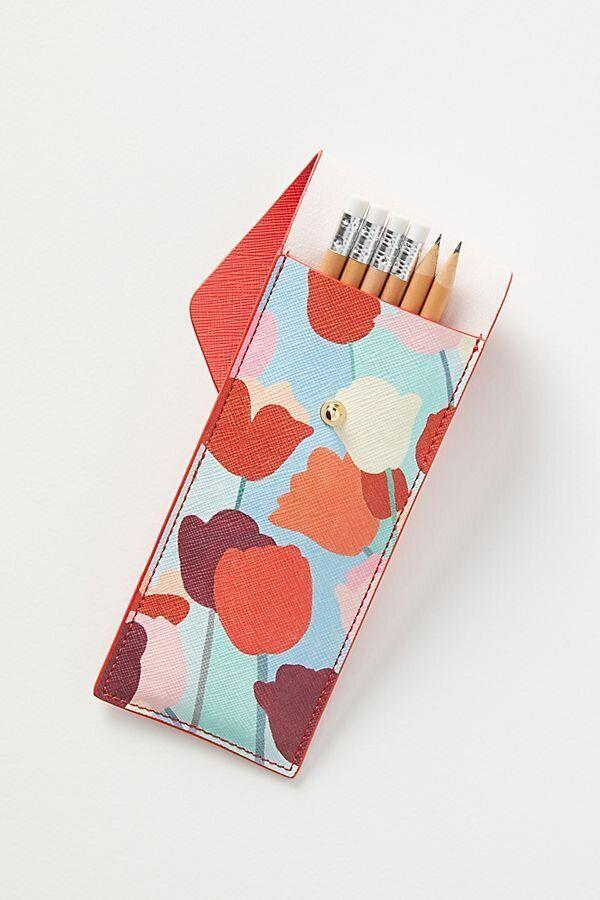 "If you don't have room for a pencil cup, this pouch won't take up too much space. You won't ever be scrambling for a pen. <a href=""https://fave.co/2xkuZ4c"" target=""_blank"" rel=""noopener noreferrer"">Find it for $24 at Anthropologie</a>.&nbsp;"