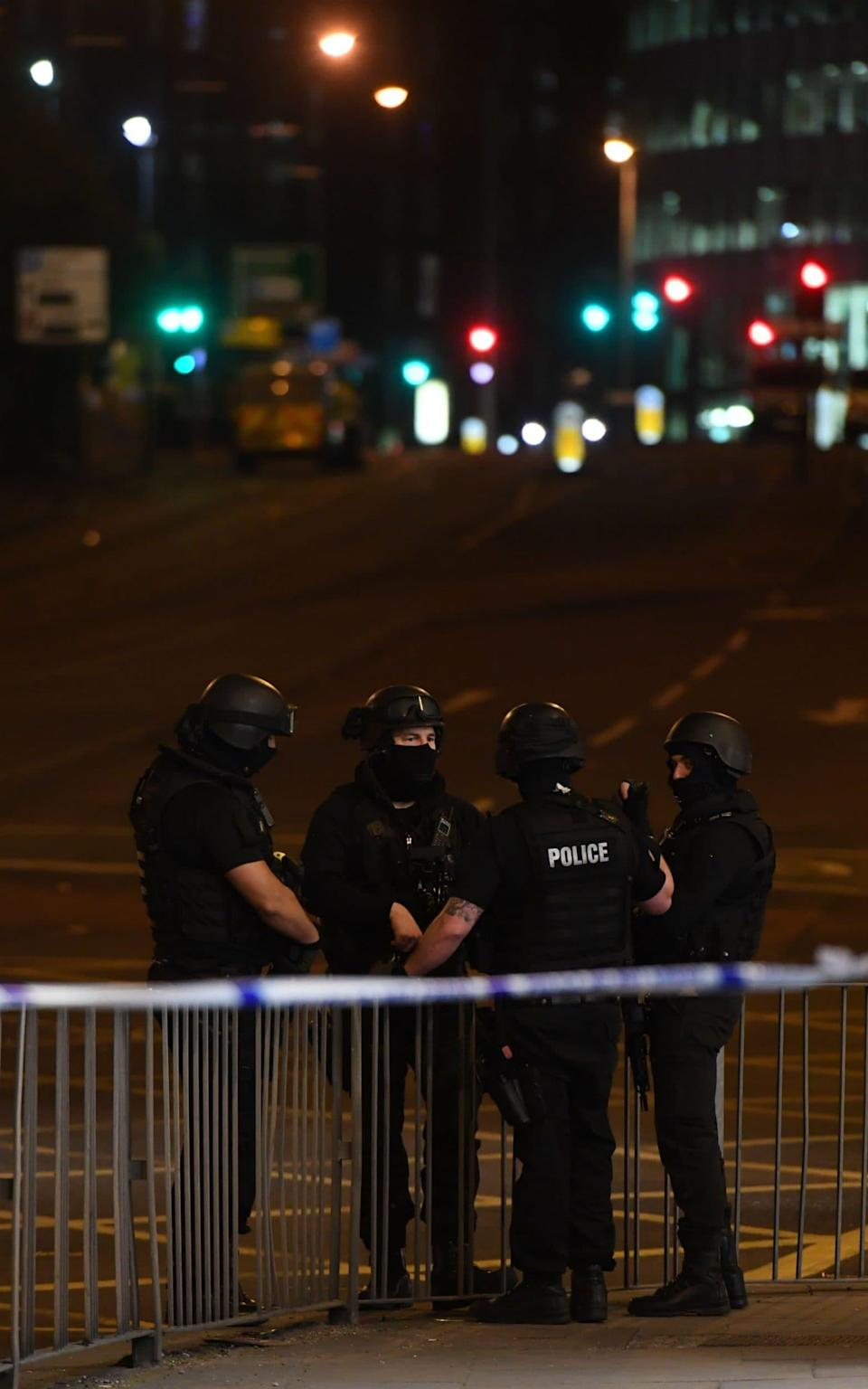 Armed police stand guard at the scene of the suspected terrorist attack - Credit: AFP