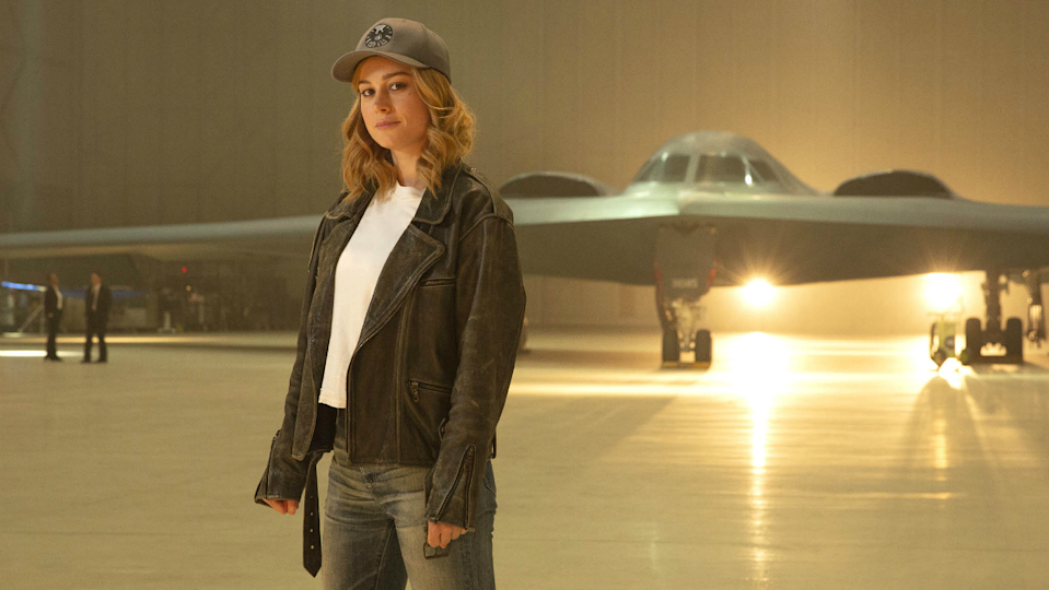 Carol Danvers in front of a jet