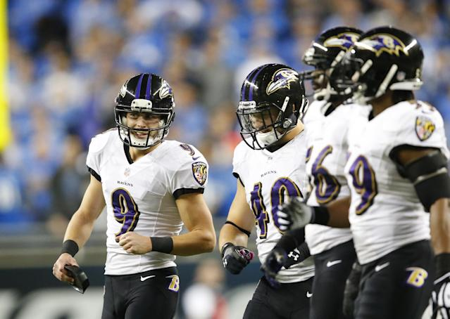 Baltimore Ravens kicker Justin Tucker (9) is seen with teammates after his 61-yard field goal to take the lead against the Detroit Lions. The Ravens won 18-16 in Detroit, Monday, Dec. 16, 2013. (AP Photo/Paul Sancya)