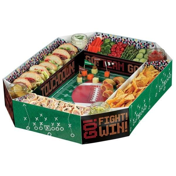 "<p>Serve up your snacks in style with this <a href=""https://www.popsugar.com/buy/Football-Snack-Stadium-Chip-Dip-Platter-483403?p_name=Football%20Snack%20Stadium%20Chip%20and%20Dip%20Platter&retailer=wayfair.com&pid=483403&price=27&evar1=savvy%3Auk&evar9=46514589&evar98=https%3A%2F%2Fwww.popsugar.com%2Fsmart-living%2Fphoto-gallery%2F46514589%2Fimage%2F46531417%2FFootball-Snack-Stadium-Chip-Dip-Platter&list1=college%2Cfootball%2Ctailgating&prop13=api&pdata=1"" rel=""nofollow"" data-shoppable-link=""1"" target=""_blank"" class=""ga-track"" data-ga-category=""Related"" data-ga-label=""https://www.wayfair.com/kitchen-tabletop/pdp/amscan-football-snack-stadium-chip-and-dip-platter-amsc1673.html"" data-ga-action=""In-Line Links"">Football Snack Stadium Chip and Dip Platter</a> ($27).</p>"