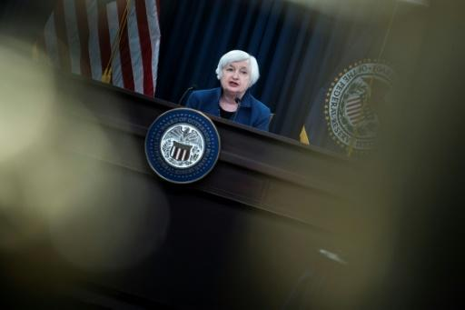 US stocks rise, dollar falls as Fed hikes rates