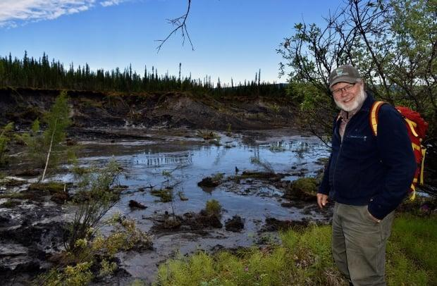 Slumps and landslides are becoming more common in Yukon as permafrost thaws and soil becomes more unstable, says Carleton University researcher Chris Burn, who's been studying permafrost in Yukon for more than 40 years. (Carleton University - image credit)