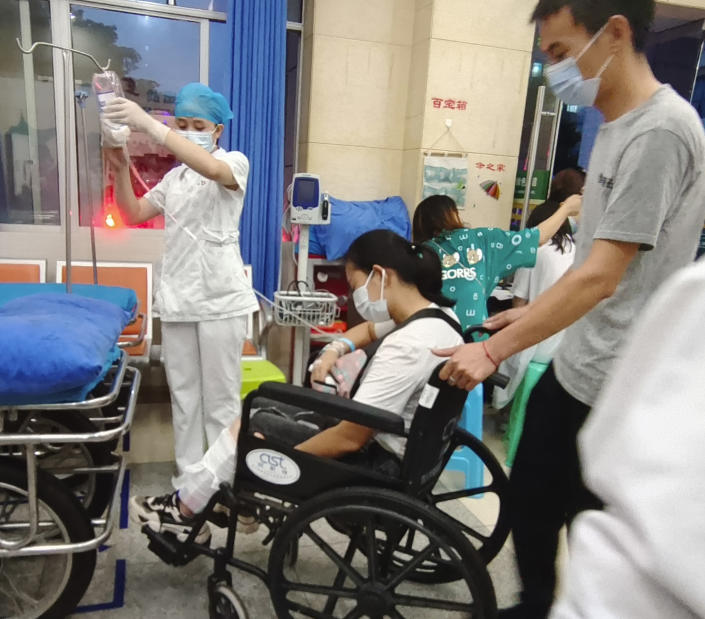 In this photo released by Xinhua News Agency, residents injured in the aftermath of an earthquake get treated at the Luxian People's Hospital in Luxian County, southwest China's Sichuan Province, Thursday, Sept. 16, 2021. An earthquake collapsed homes, killed some and injured others Thursday in southwest China's Sichuan province, state media reported. (Gu Youcong/Xinhua via AP)