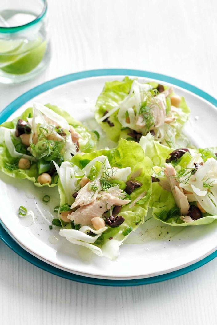 """<p>Serve these tasty tuna lettuce cups with chopped olives and feta for a fresh and healthy snack.</p><p><a href=""""https://www.womansday.com/food-recipes/food-drinks/recipes/a50954/tuna-chickpea-lettuce-cups/"""" rel=""""nofollow noopener"""" target=""""_blank"""" data-ylk=""""slk:Get the recipe for Tuna and Chickpea Lettuce Cups."""" class=""""link rapid-noclick-resp""""><u><em>Get the recipe for Tuna and Chickpea Lettuce Cups.</em></u></a></p>"""